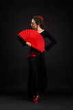 Flamenco espanhol novo da dança da mulher no preto Imagens de Stock Royalty Free