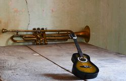 A flamenco guitar and a jazz trumpet. The old jazz trumpet player Stock Photos
