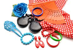 Flamenco ornaments. Consisting of fans, castanets, bracelets surrounded by white background royalty free stock image