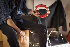 Flamenco fusion percussion instruments played at the same time. royalty free stock photos