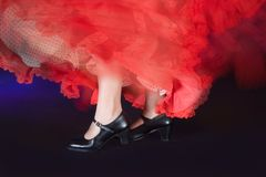 Flamenco shoes. Detail of the whirling skirt and stamping feet of a flamenco dancer Royalty Free Stock Photography