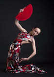 Flamenco woman dancer posing with red fan Stock Photo