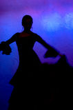 Flamenko dancer silhouette. Flamenco dancer silhouette over blue background Royalty Free Stock Image