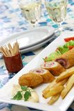 Flamenquin, deep fried long pork roulade, spanish cordoba cuisine. On white background Stock Images