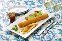 Flamenquin, spanish deep fried long pork roulade. Flamenquin, deep fried long pork roulade, spanish cordoba cuisine Royalty Free Stock Images