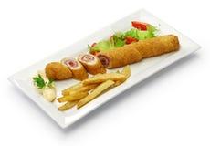 Flamenquin, deep fried long pork roulade, spanish cordoba cuisine. Isolated on white background Stock Images