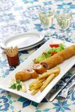 Flamenquin, deep fried long pork roulade, spanish cordoba cuisine. On white background Royalty Free Stock Photography