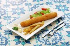 Flamenquin, spanish deep fried long pork roulade. Flamenquin, deep fried long pork roulade, spanish cordoba cuisine Royalty Free Stock Photo