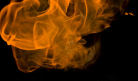 Flames. Orange before black background, blurry Royalty Free Stock Images