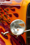Flames. Colorful flaming paintwork and headlamp on a custom hotrod Royalty Free Stock Image