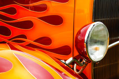 Flames. Colorful flaming paintwork and headlamp on a custom hotrod Royalty Free Stock Photo