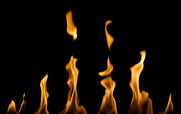 Flames. Row of flames from a fireplace on a black background Stock Photos