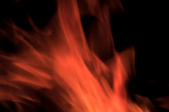 Flames. With a black background Stock Photos