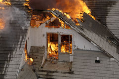 Flames from above. Upper part of house on fire royalty free stock photos