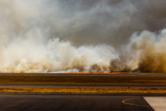 Flames from Airport Brush Fire in El Salvadore, Central America Stock Images