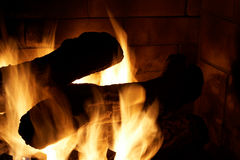 Flames around logs in gas fire Royalty Free Stock Photo