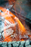 Flames and ashes. Ashes, flames and glowing ember stock images