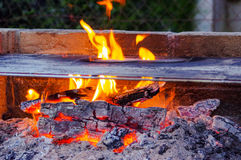Flames on a Barbecue grill with lot of charcoal Stock Photography