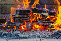 Flames on a Barbecue grill with lot of charcoal Royalty Free Stock Photography