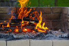 Flames on a Barbecue grill with lot of charcoal Royalty Free Stock Photo
