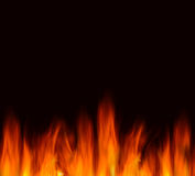 Flames on a black background Stock Image