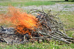 Flames from brushfire. Burning brush to clean up the land royalty free stock photography
