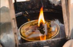 Flames burn in oil burners Stock Photos