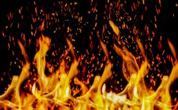In flames, burning, with a black background. Stock Photography