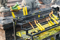 Flames burning candles at the temple in Thailand stock images
