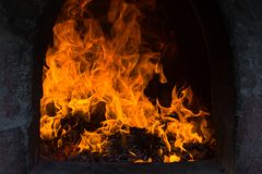 The flames are burning in the furnace. Blazing flames flare in the furnace.  stock photography