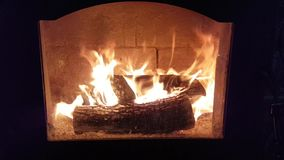 Fire in fireplace. Flames on burning log in fireplace - home comfort heater stock footage