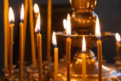 The flame of Church candles lit in the Church stock photo