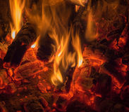 Flames coals. The flames dancing on the last coals Royalty Free Stock Photo