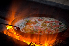 Flames with cooking pan Stock Photography
