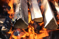Flames on dark wood Stock Photography