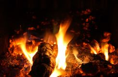 Flames and ember. Warmth of the fireplace - flames and ember stock photography