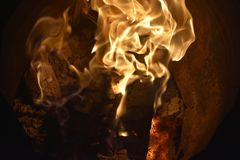 Flames or fire. Bar-b-q behaviour black blazing balefire broil burn campfire close closeup cooking danger dangerous Stock Image