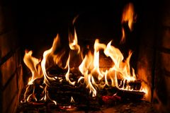 Flames of fire on a black background. The mystery of fire stock photo