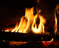 Flames. Fire burning wood to wood in the dark Stock Photos