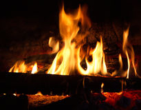 Flames. Fire burning wood to wood in the dark Stock Photography