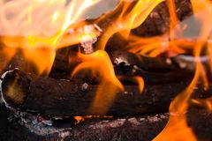 Flames of fire from charcoal as background.  Royalty Free Stock Images