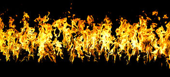Flames of a fire in the dark Royalty Free Stock Image