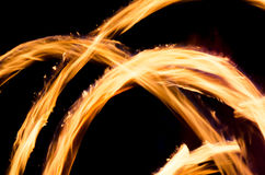 Flames of fire in darkness Stock Images