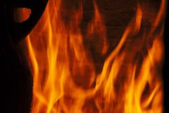Flames of fire. In the fireplace with a pot put warm stock images