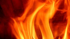 Flames of fire in fireplace stock video footage