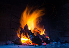 Flames in fire place. Hot flames burnning in a fire place royalty free stock photos