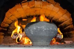 Flames  of the fire and the pot in the wood fired oven in the village house stock images