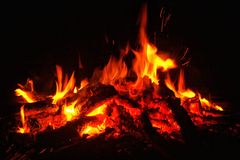 Flames. Fire of wood . The fire resulting from the burning of wood . flame red . This photo dimabil at night . visible flames burning Royalty Free Stock Photography