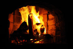 Flames in fireplace Royalty Free Stock Photography