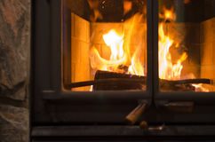 Flames in a Fireplace. Warm us up on a winter night Stock Photos